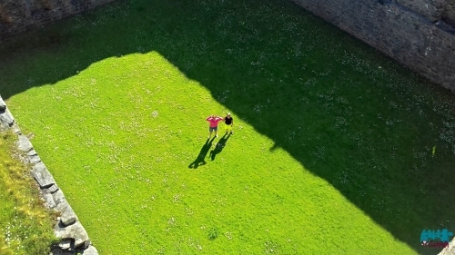 A photo looking down from Skipness Castle roof to the Courtyard.