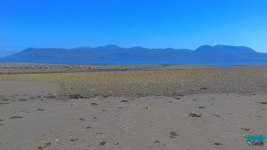 A photo from the beach at Skipness looking toward the Isle of Arran on the horizon