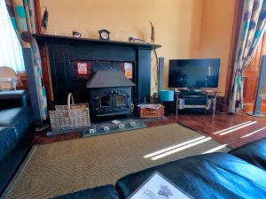 Guest Lounge with wood burner