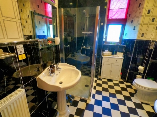 Arran Suite Bathroom, walk-in shower and basins