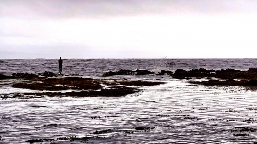 """Saddell Bay and the view seaward with Antony Gormley's """"Grip"""""""