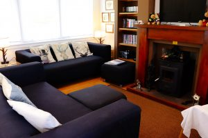 Ground floor living room with multi-fuel fire Cuilidh, Kintyre Holiday Home self-catering Scotland
